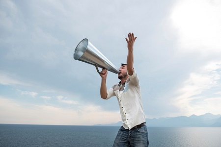 stock-photo-83343459-man-yelling-trough-a-megaphone[1]